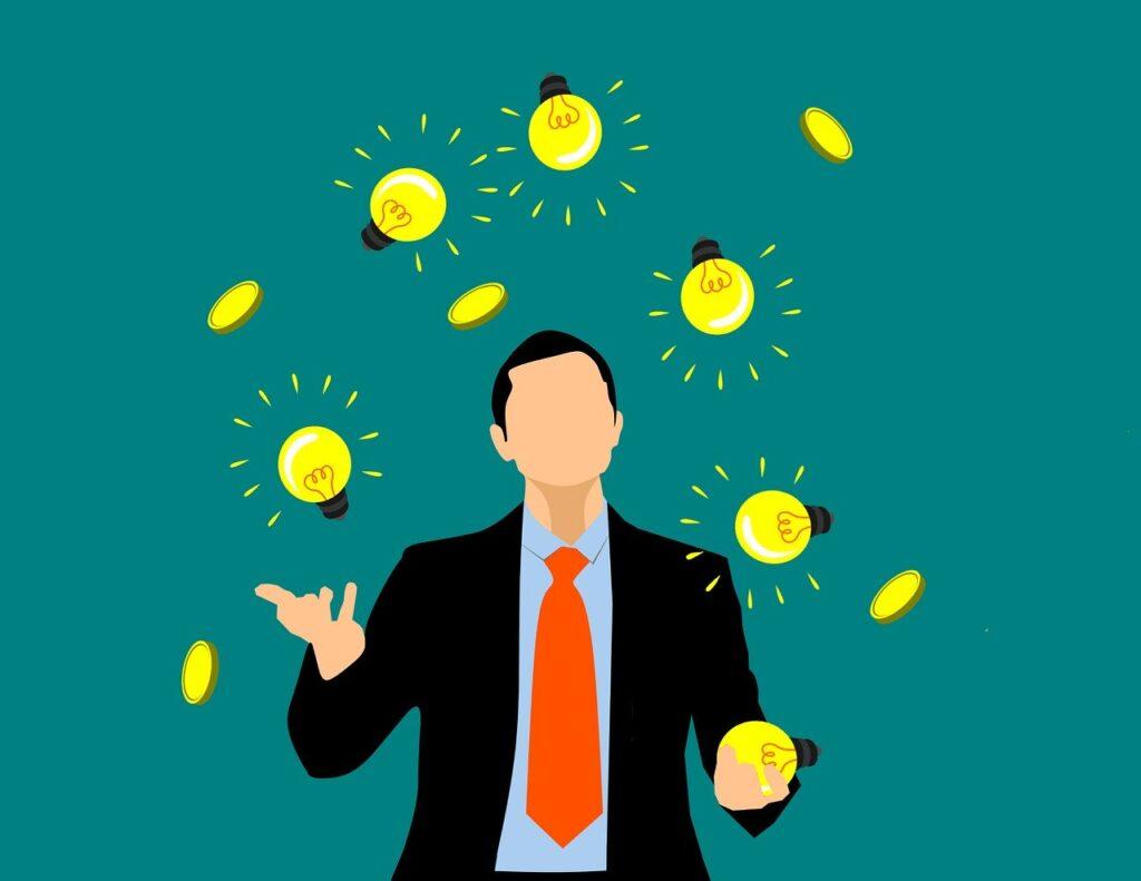 man juggling light bulbs
