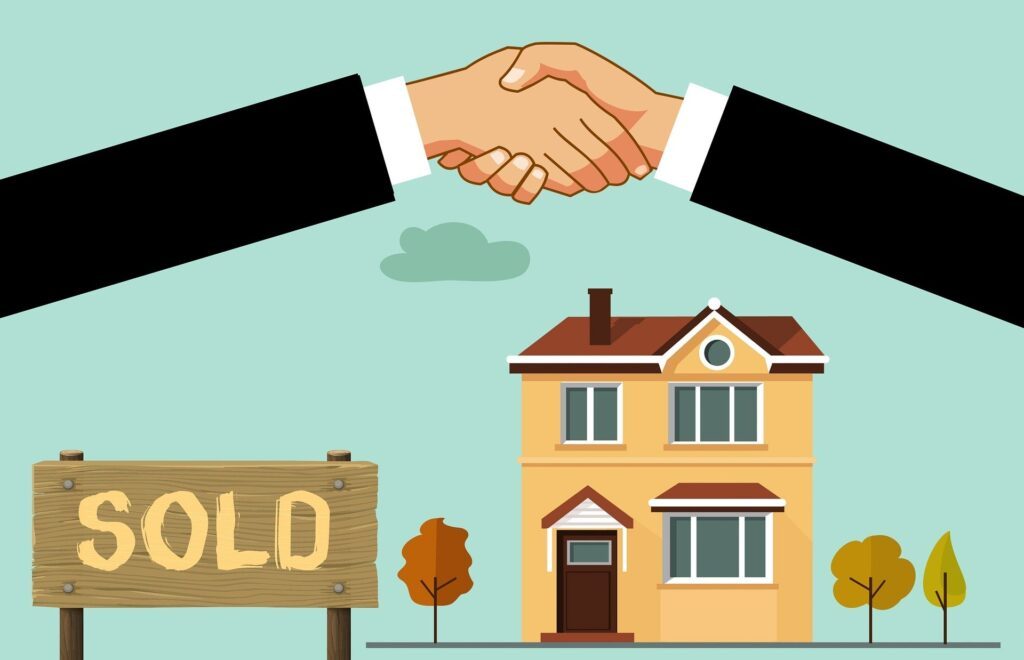 Hand shake agreeing a house sale